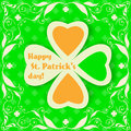 St patrick day card big paper clover and floral frame on green background with clover pattern Stock Images