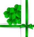 St patrick day card bouquet of clovers and green bow on orange paper background Royalty Free Stock Photography