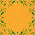 St patrick day card green floral frame with clovers on orange background with clover pattern and old paper texture Stock Images