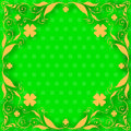 St patrick day card orange floral frame with clovers on green background with clover pattern Stock Photography