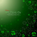 St. Patrick`s Day background,Green shamrock with light on black