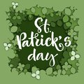 St. Patrick`s day calligraphy logo on green paper cut clover background