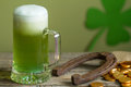 St. Patrick's Day green beer and horseshoe Royalty Free Stock Photo