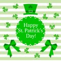 St. Patrick`s Day greeting. Vector illustration of hat with bow and clover leaves on white and light green strips.