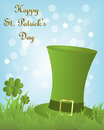 St patricks day background green irish hat in the grass with clovers on light blue bokeh for Stock Images