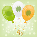 St patricks day balloons with irish flag colors and clover on light green bokeh background for Stock Image