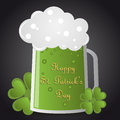 St patricks day beer green glass of and clover on dark background for Stock Photography