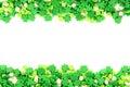 St patricks day candy frame of green shamrock sprinkles over white Stock Photography