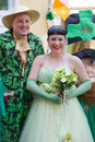 St patricks day couple candid portrait of happy dressed up in green bride and groom during saint brisbane march Stock Image