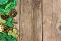 St Patricks Day decor side border over rustic wood Royalty Free Stock Photo