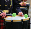 St patricks day drummer a from a fire fighters pipes and drums band with green sticks Stock Photo