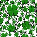 St Patricks Day seamless pattern green clover weaving with lianas background