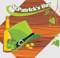 St. Patricks Day hat and beer bottle on the wooden Royalty Free Stock Images