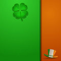 St patricks day leather background with shamrock and hat on a green Stock Photography