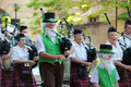 St patricks day parade bagpipes band during the saint brisbane march one man wear the leprechaun costume Stock Image