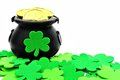St patricks day pot of gold and shamrocks over white Royalty Free Stock Photography