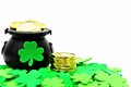 St patricks day pot of gold and shamrocks over white Stock Photography
