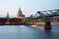 St Paul's cathedral and Millennium bridge in London at dusk Royalty Free Stock Photo