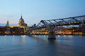 St Paul's Cathedral and Millennium bridge in London at night Royalty Free Stock Photo