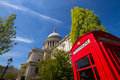 St paul s cathedral and phone box a typical red outside london on a beautiful spring day landscape orientation Stock Images