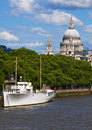 St. Pauls Cathedral and Thames Boat Royalty Free Stock Photography