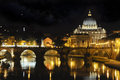 St peter basilica and tiber river at night view of angelo bridge dome with reflections on Royalty Free Stock Photography