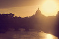 St. Peter's Basilica, Vatican City. Tiber river in Rome, Italy at sunset