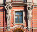 St petersburg detail of the exterior of the belosselsky belozersky palace facade two atlases squlptures holding the balcony russia Royalty Free Stock Photos