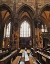 St. Sebaldus Church, gothic interior, tall columns, vaults, arches and windows Royalty Free Stock Photo