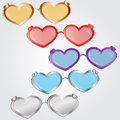 St valentine s glasses from in the form of two hearts of different color in a Stock Images