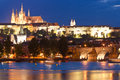 St vitus cathedral prague castle and charles bridge pretty night time illuminations of reflected in the vltava river running Royalty Free Stock Photography