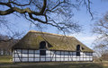 Stable under a thatched roof in the national park Stock Photos