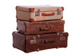 Stack of aged suitcases on white Stock Photos