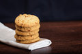 Stack of apple chip cookies on white table napkin close up stacked wooden background Stock Images