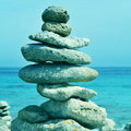 Stack of balanced stones in menorca balearic islands spain picture a typical cap de cavalleria with a retro effect Royalty Free Stock Image