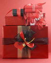 Stack of beautiful love theme red present gifts Royalty Free Stock Images