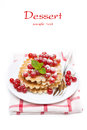 Stack of belgian waffles with red currants on a plate isolated white space for text Royalty Free Stock Image