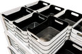 Stack of black plastic trays arrangement for background Royalty Free Stock Photo