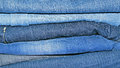 Stack of blue jeans background Stock Photography