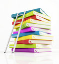Stack of book and white ladder Stock Image