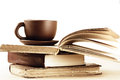 Stack of books and cup on wooden table shallow dof Stock Photos