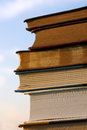 Stack of books in front of sky a several old novels and bibles are piled outside with the blue behind them the background Royalty Free Stock Image