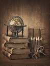 Stack of books and globe on wooden table Royalty Free Stock Images