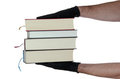 Stack of books in hands with black gloves Royalty Free Stock Photography