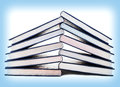Stack of books isolated on white and blue Stock Photography