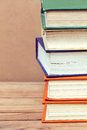 Stack of books vintage on wooden table Royalty Free Stock Images