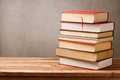 Stack of books on wooden table over rustic background Royalty Free Stock Photo