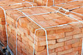 Stack of brick orange clay on construction site Stock Images