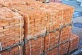 Stack of brick orange clay on construction site Royalty Free Stock Photo