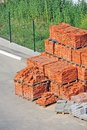 Stack of brick orange clay on construction site Royalty Free Stock Images